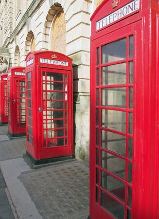 a line of typical old fashioned british red public telephone boxes outside the former post office in Blackpool Lancashire