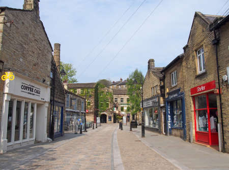 hebden bridge, west yorkshire / united kingdom - 20 May 2020: bridge gate in the centre of hebden bridge with shops and cafes on either side of the road