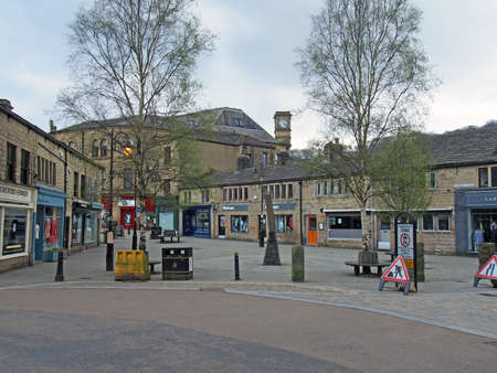 hebden bridge, west yorkshire / united kingdom - 20 May 2020: weavers square in the centre of hebden bridge surrounded by shops and cafes with no people