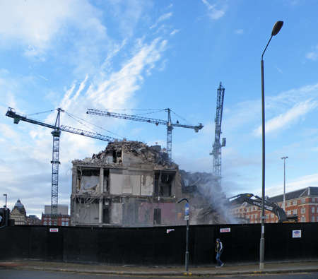 Leeds, United Kingdom - 11 November 2014: Cranes working on the demolition of the former milgarth police station in leeds prior to the construction of the victoria quarter shopping centre