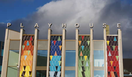 Leeds, West Yorkshire, United Kingdom - 22 February 2020: the brightly coloured facade of the new west yorkshire playhouse theatre building against a bright cloudy blue sky