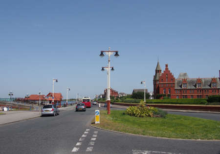 southport, merseyside, united kingdom - 28 june 2019: a view along the promenade road in southport with seafront traffic and hotel buildings in summer