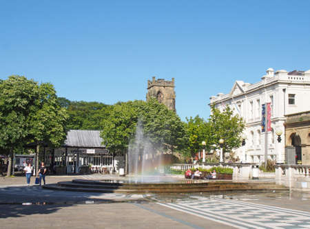 southport, merseyside, united kingdom - 28 june 2019: a street view of the square and cafe building with the town hall in southport merseyside
