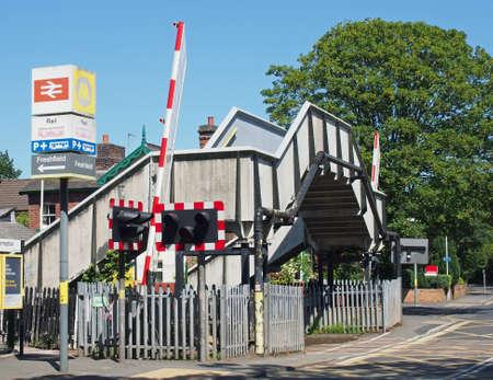 formby, merseyside, united kingdom - 28 june 2019: the footbridge and road crossing barrier at freshfield railway station near formby in merseyside