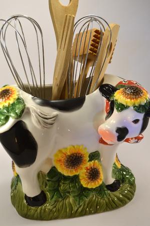 utencils: utencils in a cow container Stock Photo