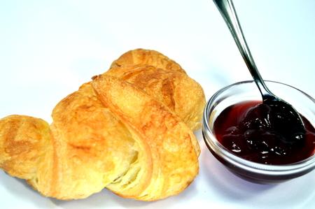 heart burn: A croissant with jam.