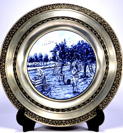 tiers: tain plate with a painting of m  tiers of yesteryear.