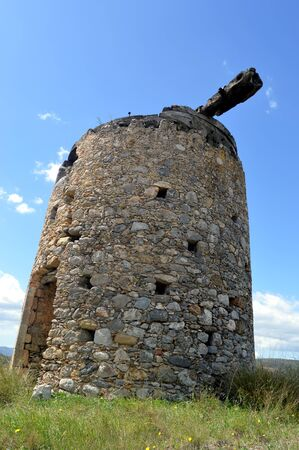 gets: An old mill gets wind in Greece.