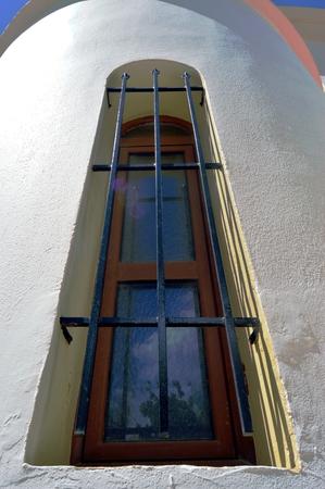 iron barred: A rectangular window with bars black.