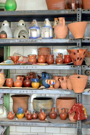 planters: Shelf of potteries of all kind in a business. Stock Photo