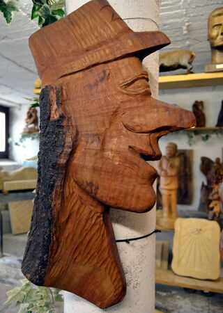 long nose: Sculpture of a wooden head with a long nose. Stock Photo