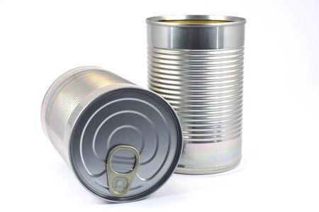 limp: Limp with can of food in standing stainless steel and bedtime on white bottom.