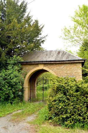 stone arch: Stone portico of size with an arch and an iron railing to forge.