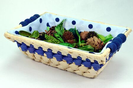 flower bath: Small basket with flowers and plantes de colors green, red, blue and green.