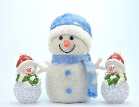 trio: Trio of snowman with a glass ball.