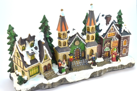dickens: Village of Christmas in plaster under the snow.