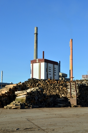 fireplaces: Pulp mill with two fireplaces, wood and a blue sky