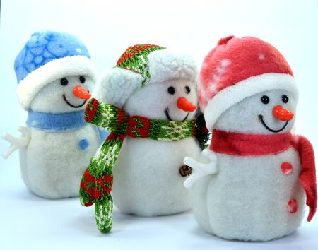trio: Trio of snowman in a row on a white background Stock Photo