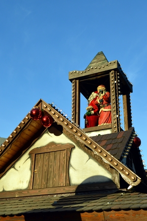 pere noel: Mom and papa christmas on a wooden tower on a cottage
