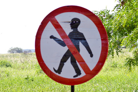 savana: Prohibition sign to walk in the savanna of West Tsavo Park in Kenya