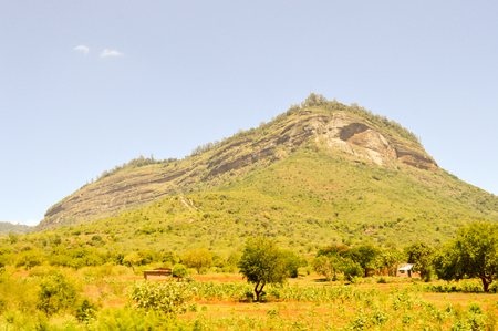 Hill in the Savannah of Tsavo West Park in central Kenya Stock Photo