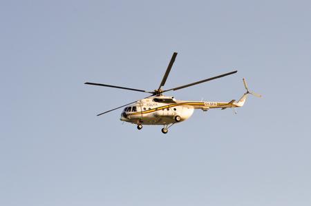 Kenyan police helicopter flying over Indian Ocean near Mombasa, Kenya Stock Photo