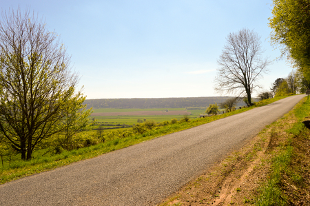 Small winding road in the countryside of the Meuse in France