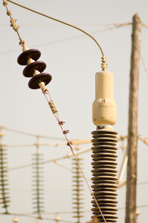 High-voltage insulators in a thermal power plant on the island of Crete Stock Photo