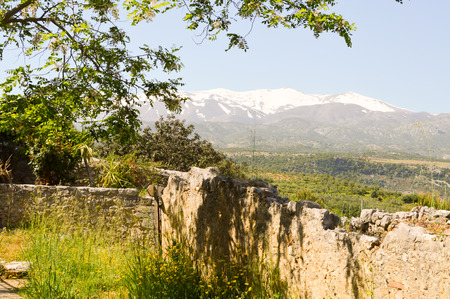 White mountains of the psilotoris in Crete with in the foreground an old wall of abbey