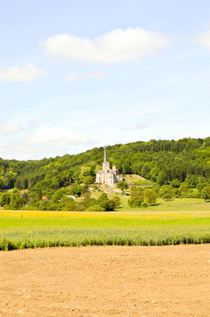 Cultures and church of Notre-Dame de Mont-Devant-Sassey in the department of the Meuse