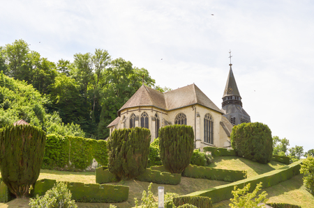 Small church on a hill with trees carved in the department of the Meuse in France