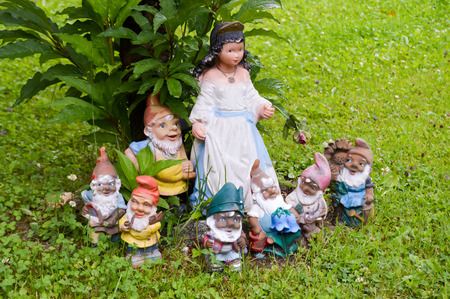 seven dwarfs: White snow and the seven dwarfs on a lawn of the Tyrol in Austria Stock Photo