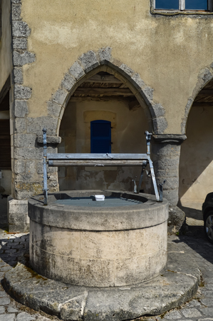 Old stone well with salamanders forging in a small village near the lake of madine in the department of meuse in France