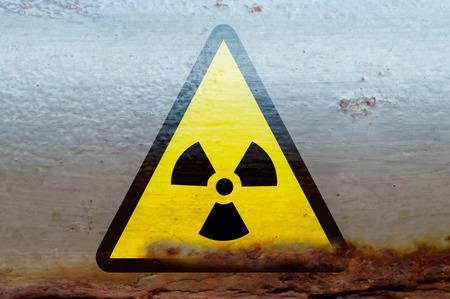 radioactive warning symbol: Radioactive radiation warning on the rusty container, image with a symbol Stock Photo