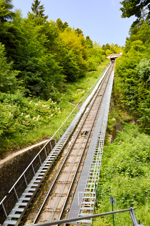 View of the rails of a funicular in the mountains of northern Italy Stock Photo