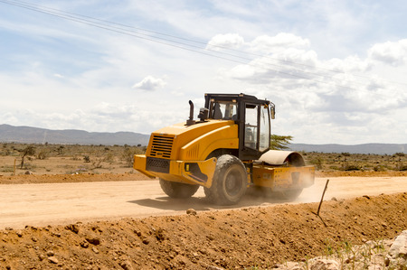 Road Roller Compactor on New Mombasa Road to Nairobi, North West Kenya Stock Photo