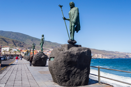 Candelaria,Spain,Europe-29042018.Statue of an ancient Canary Islands native guanche on the waterfront in the city of Candelaria
