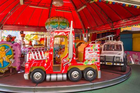 Mondello, Sicily, Europe-1006  2018.Carousel of cars and trucks on a carnival of Mondello in Sicily 新聞圖片