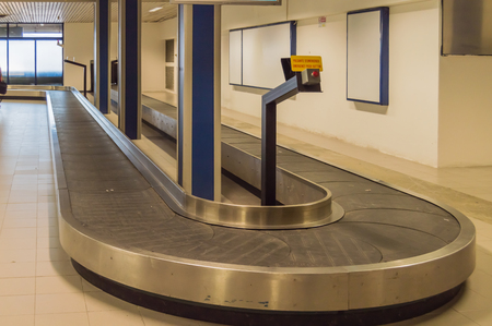 Baggage Transfer Rack and Empty Luggage at Rimini Airport in Italy Editorial