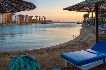 View of a lagoon of the Red Sea at sunrise between two rows of hotel room in Hurghada 版權商用圖片