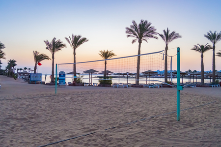Beach volleyball field on a red sea beach at sunrise in hurghada city Stock Photo
