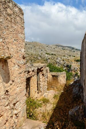 Old abandoned town. Narrow street in old Greek village. Traditional buildings. Destroyed house.  Crete Island, Greece