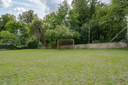 mini-football field on a lawn with a goal a little rusty in front of a wall in the region of Virton in Belgium Stockfoto