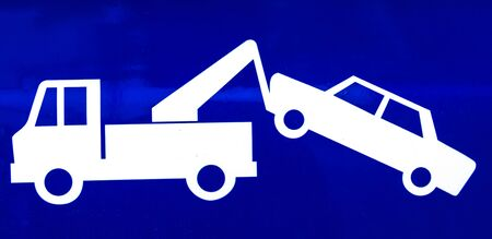 Close-up of a blue traffic sign for a suspended driver's license equal to towing and impounding, no exceptions. Stock Photo - 130216588