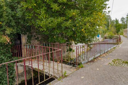 Small footbridge to the entrance of a house on the river of the tone in the city of Virton in the province of Luxembourg in Belgium