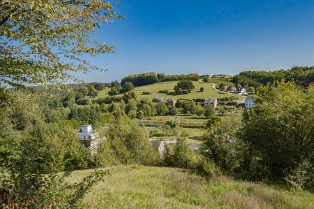 View of a hill in a meadow of the gaume in Meix in front of Virton near Virton in Belgium