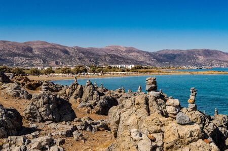 View of the city of Malia with the beaches and mountains north of the island of Crete in Greece Stok Fotoğraf