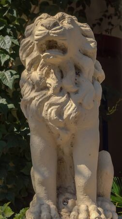 Statue of a little lion serving as decoration at the entrance of a restaurant