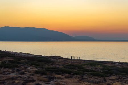 Sunset on the sea near the village of Sissi in Crete Stok Fotoğraf