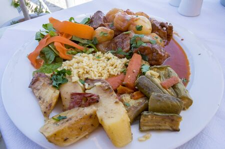 Plate of veal (stifado) prepare with onions with potatoes and rice Stok Fotoğraf